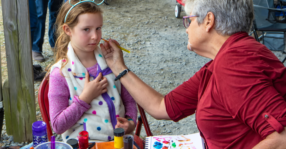 Marren Wills got her face painted by Lori Stetson